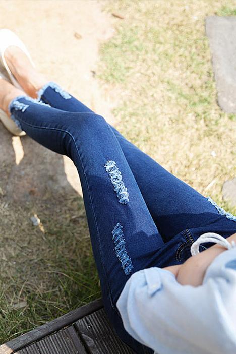 新款高腰毛边破洞铅笔小脚牛仔裤