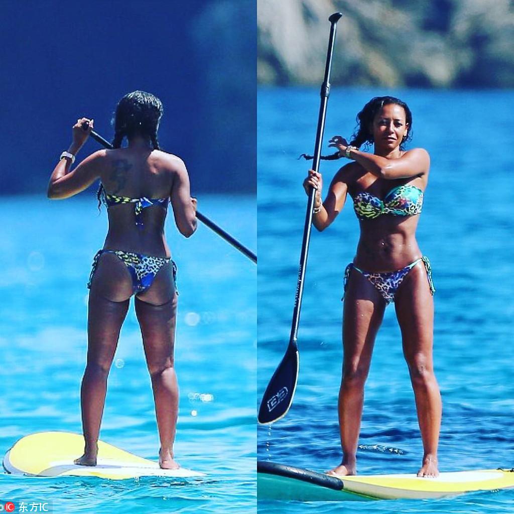 前辣妹组合成员玫兰妮·布朗(melanie brown )爱好划船,一个人在湖面